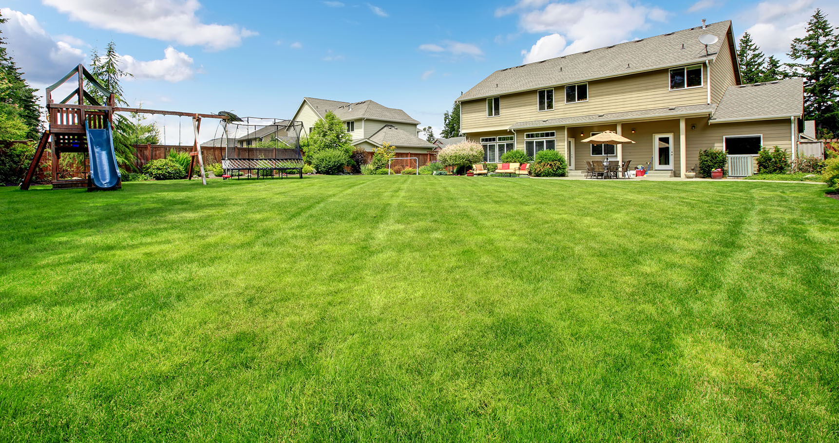 Large beautiful fenced backyard with play ground and nice house