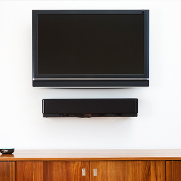 TV mounted on a white wall