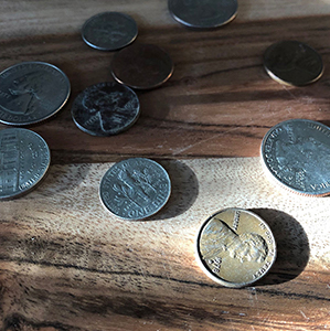 coins sitting on wood