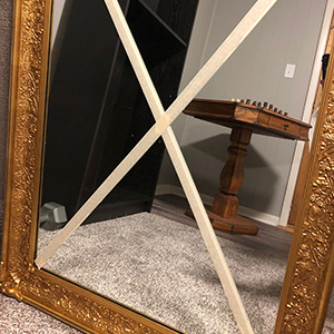 mirror with tape ready to move