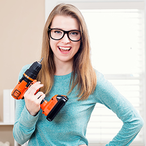 woman holding a red drill