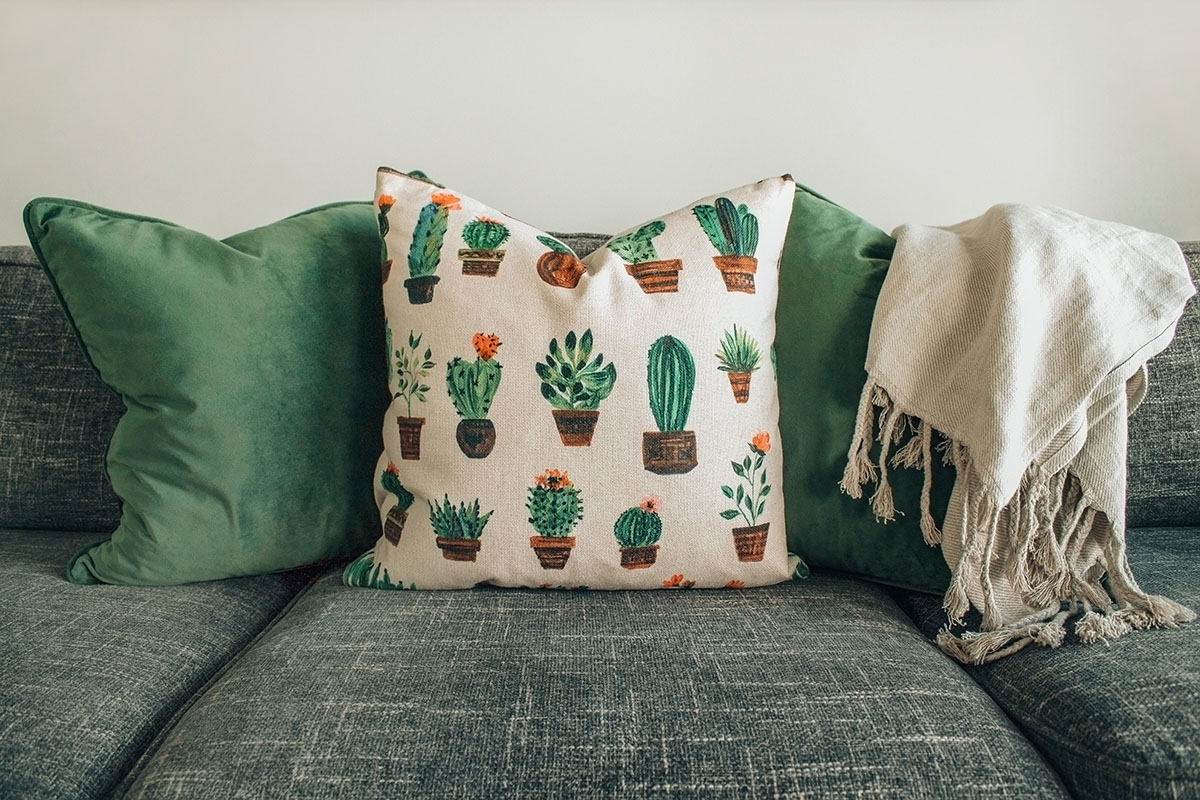 green throw pillows on a couch