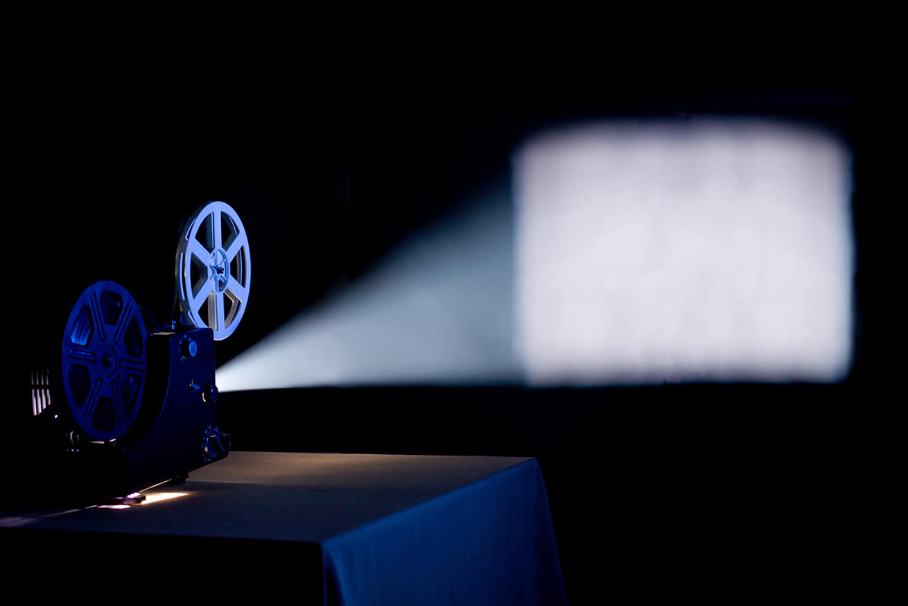 movie projector in a dark room