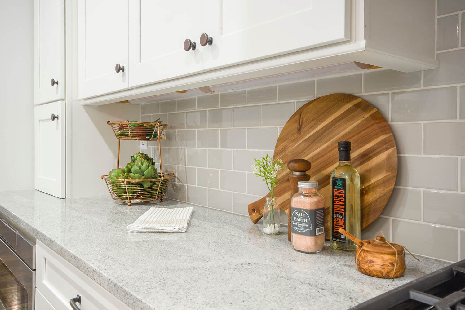 granite countertops with subway tile backsplash