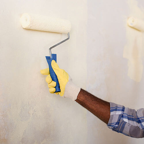 make-ready technician painting a wall