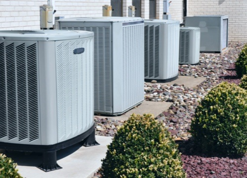 row of apartment hvac units