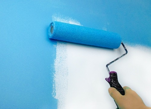 paint roller with teal paint